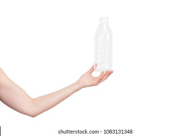 Female hand holding empty plastic bottle isolated on white. Recyclable waste. Recycling, reuse, garbage disposal, resources, environment and ecology concept