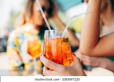 Female Hand Holding Glass With Spritz Aperol Cocktail