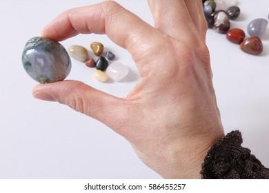 female hand holding healing stone