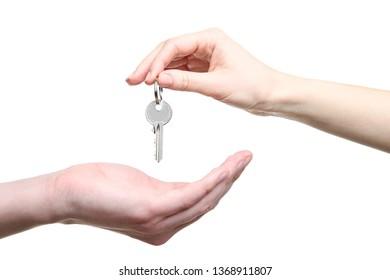 Female hand holding house key on white background