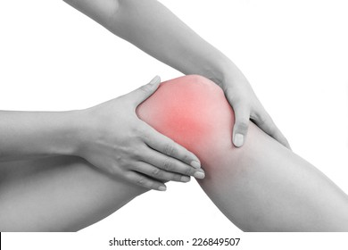 Female hand holding knee isolated on white background. Knee injury, muscle strain, sport injury.