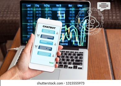 Female hand holding mobile phone showing the chatbot message While being decided place the order over the Stock market chart over the computer laptop screen, Business investment with AI concept