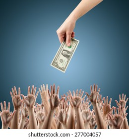 Female hand holding money dollars offering them many hands reaching out for earning money. Rich and poor concept. Competition in the labor job market. Line for unemployment benefits Blue background