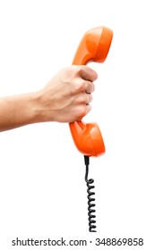 Female hand holding a orange handpiece from a vintage telephone