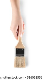 Female hand holding painting brush on white background, top view
