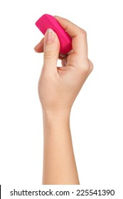 female hand holding a pink eraser to erase on a white background