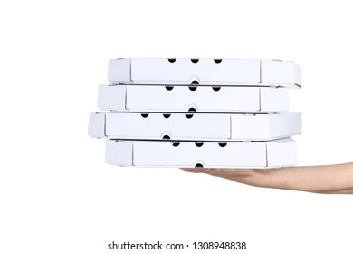 Female hand holding pizza boxes on white background