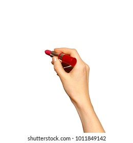 Female hand holding red lipstick, isolated on white