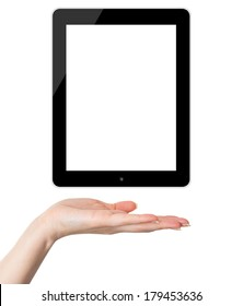 Female hand holding and showing black tablet PC similar to ipade