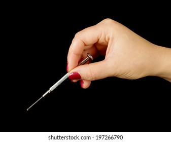 Female hand holding small philips screwdriver