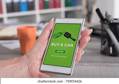 Female hand holding a smartphone with car sale concept