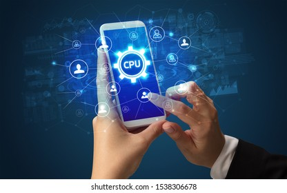 Female hand holding smartphone with CPU abbreviation, modern technology concept
