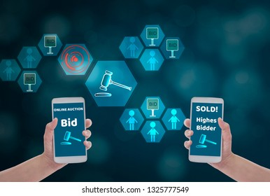 Female hand holding smartphone to Enter the price for bid,via wireless network on blue bokeh background with auction icon, Concept online auction via website ,application and modern technology