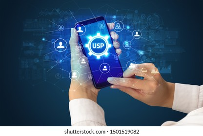 Female hand holding smartphone with USP abbreviation, modern technology concept