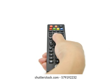 Female hand holding TV remote control. Isolated on white background