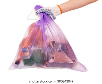 Female hand holding a waste bag isolated on white background.