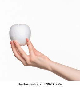 The female hand holding white blank styrofoam oval