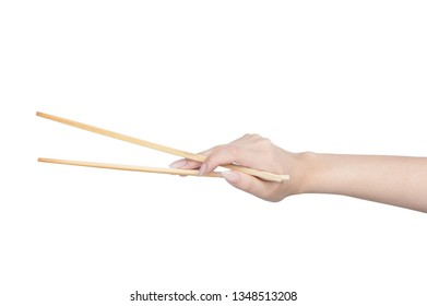 Female hand holding wooden chopsticks isolated on white