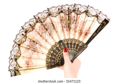 The female hand holds a beautiful fan opened on a white background closeup