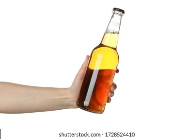 Female hand holds bottle of cider, isolated on white background