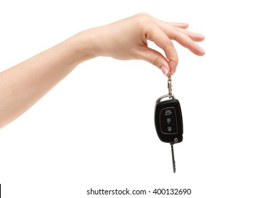 Female hand holds car keys on white background.