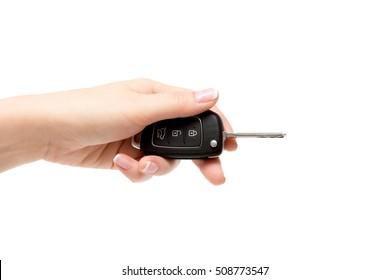 Female hand holds car keys.