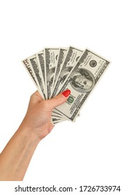 female hand holds dollars isolated on a white background