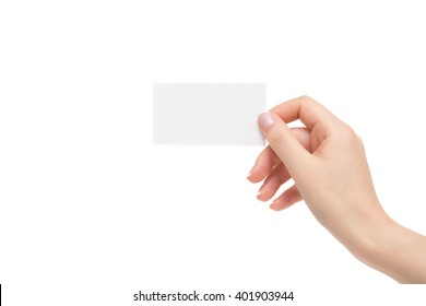 Female hand holds white card on a white background.