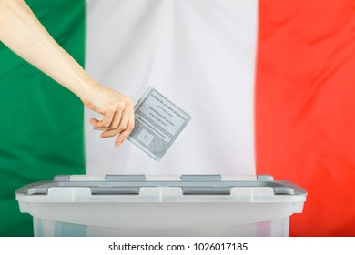 Female hand keeps ballot over ballot box. Translation from Italian. Election to the Chamber of Deputies. Overseas Constituency. Europe. Ballot paper. Election stamp