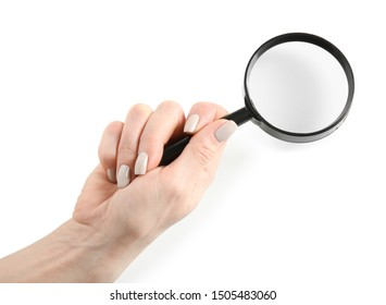 Female hand with magnifier on white background