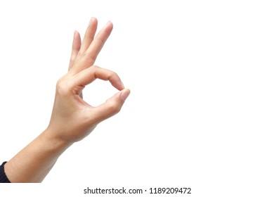 Female hand making ok sign isolated on white background
