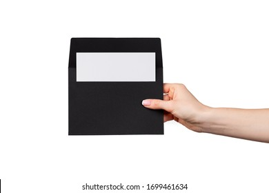 Female hand with manicure holding envelope isolated on white background