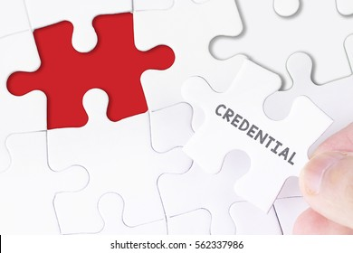 Female hand and missing puzzle with CREDENTIAL WORD