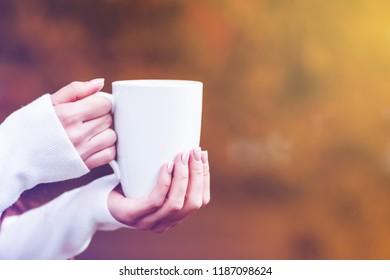 female hand with mug, toned