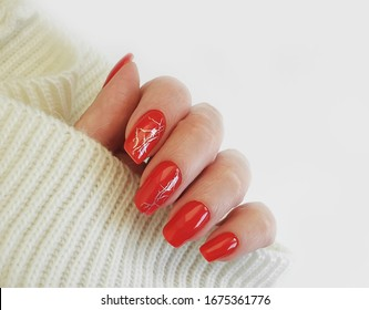 female hand nails manicure red