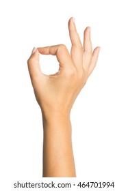Female hand OK sign isolated on white background