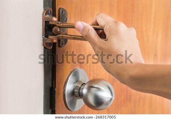 Female hand on handle, opening or closing door