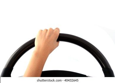 Female hand on a steering wheel on the isolated white background