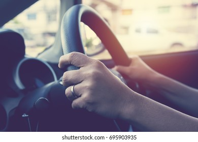 Female hand on steering wheel. Travel and safty concept.