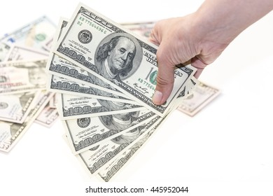 Female hand with one hundred  dollars banknotes