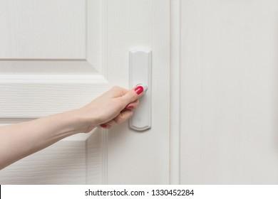 Female hand, open door, front view