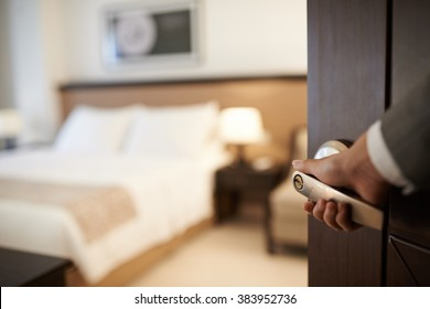 Female hand opening hotel room, selective focus