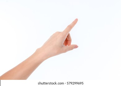 female hand outstretched to the side and pointing finger isolated on white background