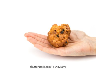 Female hand palm showing fritter or oliebol isolated on white background