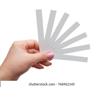 Female hand with paper test strips for perfume