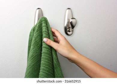 Female hand picking up a towel