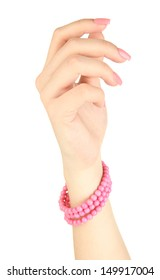 Female hand with pink manicure and bright bracelet, isolated on white