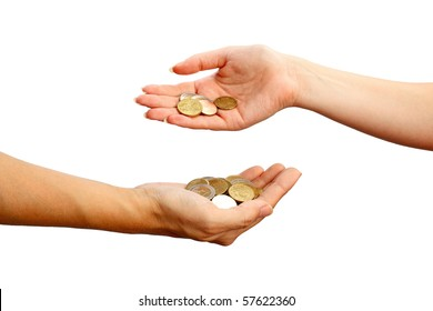 Female hand pours down coins into hand of another person, isolated on white background