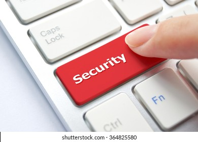 female hand pressing a red computer button saying security