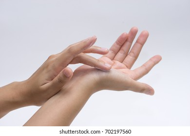 The female hand puts a cosmetic cream on other hand, isolated